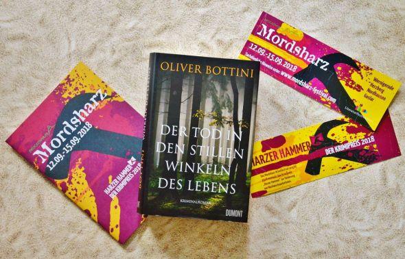 """Beim Mordsharz wird buchstäblich Ausgezeichnetes präsentiert: Oliver Bottini liest zur Eröffnung aus seinem preisgekrönten Roman """"Der Tod in den stillen Winkeln des Lebens""""."""